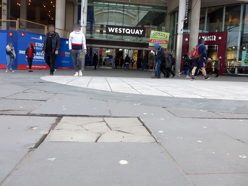 Cracked pavement outside West Quay Southampton